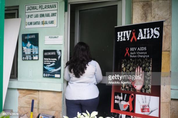 A woman enters a consultation room at the community health center Senen in Jakarta Indonesia on November 30 2017 Data from the United Nations...