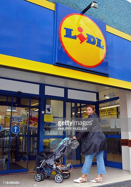 A woman enters a discount supermarket LIDL on June 16 2011 in the northern French town of Lille Six children were being treated in hospital today in...