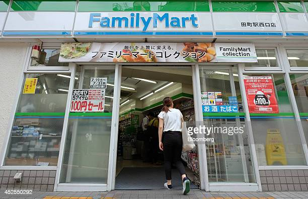 A woman enters a FamilyMart Co convenience store in Tokyo Japan on Wednesday July 23 2014 Japan suspended food imports from Shanghai Husi Food Co a...