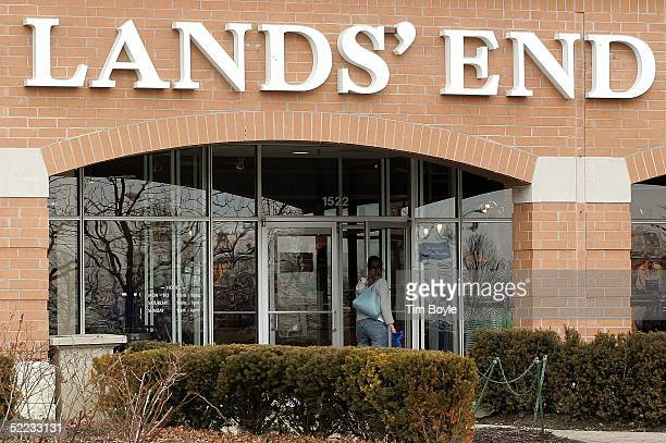 A woman enters a Lands' End outlet store February 23 2005 in Schaumburg Illinois Lands' End a unit of Sears says it will eliminate more than 375 jobs...