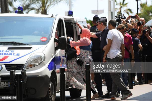 A woman enters a Police van after being arrested by Police on May 26 2017 outside the luxury Martinez hotel before she attempted with other women to...
