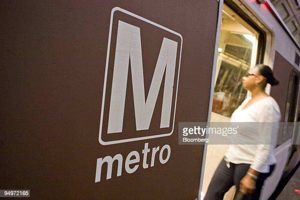 Woman enters a Red Line Metro train car at the Union Station stop in Washington, D.C., U.S., on Monday, Aug. 24, 2009. Washington's Metro, run by the...