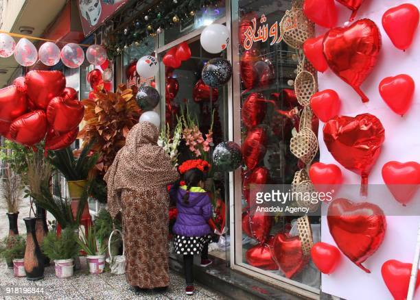 A woman enters a souvenir shop on Valentine's Day in Kabul Afghanistan on February 14 2018