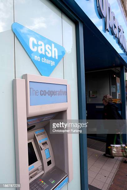 A woman enters the Crewe branch of the Cooperative Bank on November 4 2013 in Crewe United Kingdom The Cooperative Bank has announced plans to cut...