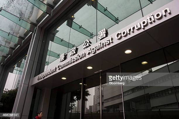 A woman enters the Hong Kong Independent Commission Against Corruption's headquarters in Hong Kong China on Saturday Feb 8 2014 The ICAC is Hong...