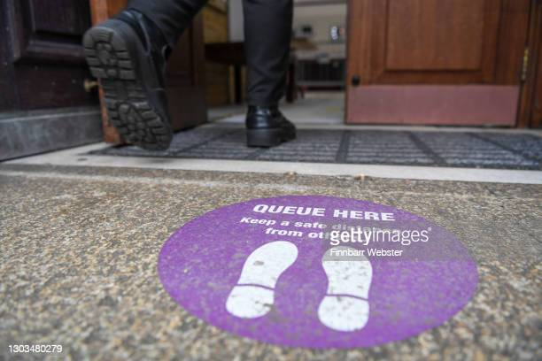 Woman enters the lateral flow test centre on February 22, 2021 in Portsmouth, England. NHS Test and Trace have provided Portsmouth City Council with...