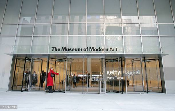 A woman enters the newly remodeled Museum of Modern Art during a media preview of the building November 15 2004 in New York City The new museum...