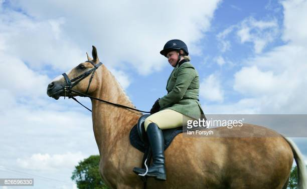 Woman enters the show arena to compete during the Osmotherley Country Show on August 5, 2017 in Osmotherley, England. The annual show hosts pony,...