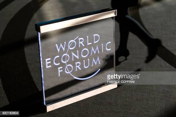 A woman enters the World Economic Forum on the closing day of the forum on January 20 2017 in Davos / AFP PHOTO / FABRICE COFFRINI
