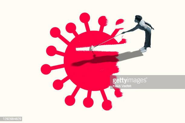 woman erasing red covid-19 virus with paint roller - strip stock pictures, royalty-free photos & images