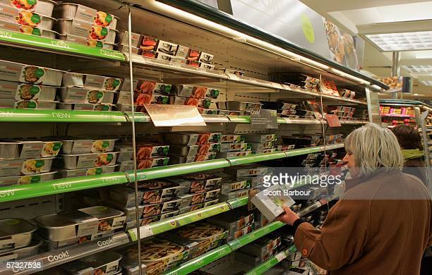 A woman examines a product on display as she shops in the food department of a Marks and Spencer store on April 11 2006 in London England Marks and...