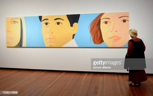 A woman examines the work of art titled 'Trio' by artist Alex Katz at the exhibition 'From Hockney to Holbein The Wuerth Collection' at the...