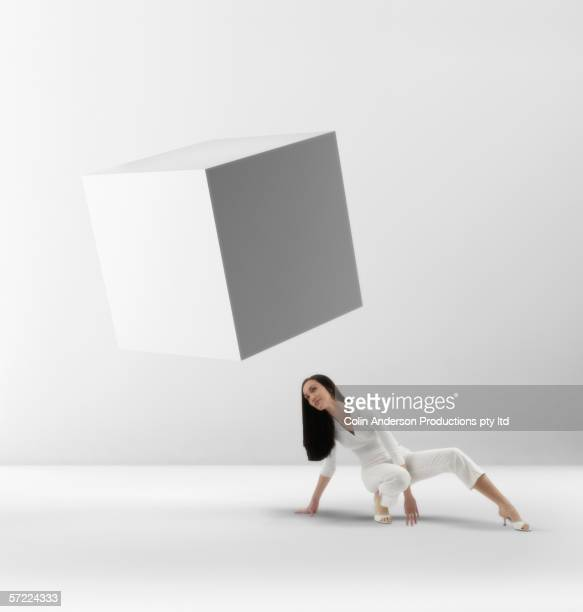 Woman examining floating object