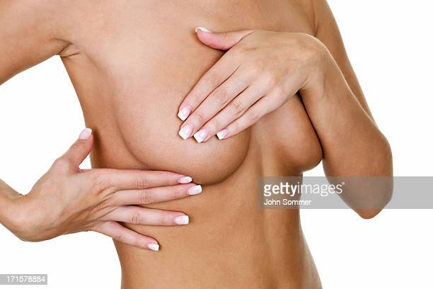 Woman examining her breast for cancer