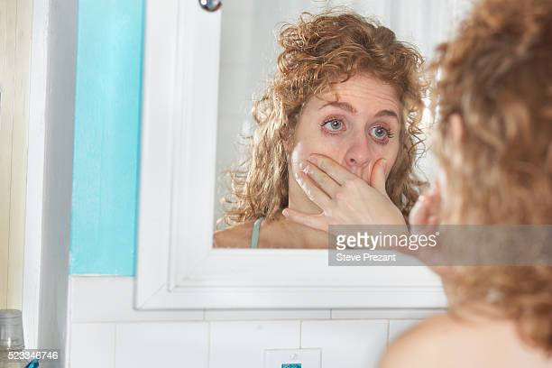 woman examining her eyes - hangover stock pictures, royalty-free photos & images