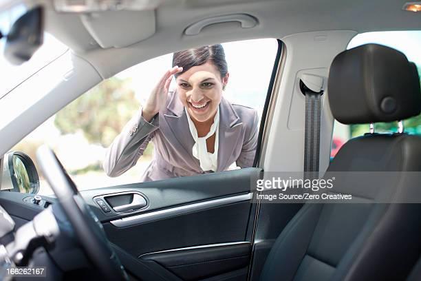 Woman examining new car