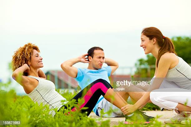 Woman Exercise Crunches Outdoors.