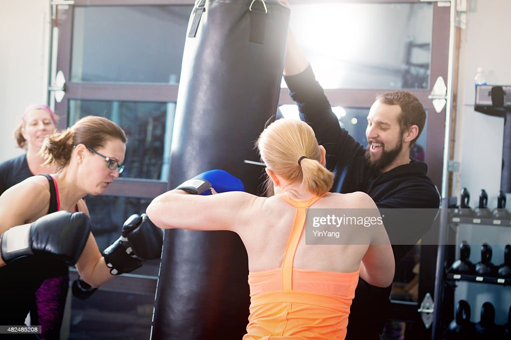 Woman Exercise Workout Boxing in Health Club Facility : Stock Photo