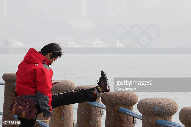 A woman exercises at the seaside in the haze on February 24 in Qingdao Shandong Province of China Altogether 143 million sq km of China's land...