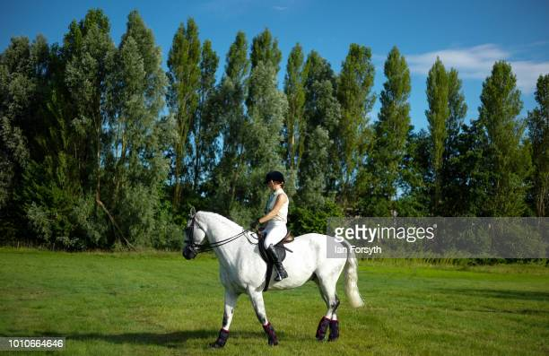 A woman exercises her horse before competing during 152nd the Ryedale Country Show on July 31 2018 in Kirbymoorside England Held in Welburn Park near...