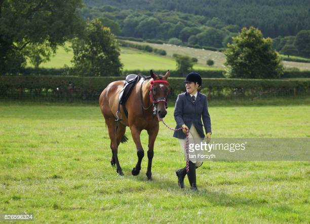 Woman exercises her horse before competing during the Osmotherley Country Show on August 5, 2017 in Osmotherley, England. The annual show hosts pony,...