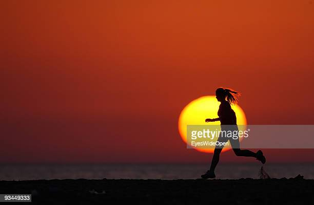 Woman Exercises on the beach at Sunset. On July 16, 2009 in Rhodes, Greece. Rhodes is the largest of the Greek Dodecanes Islands.