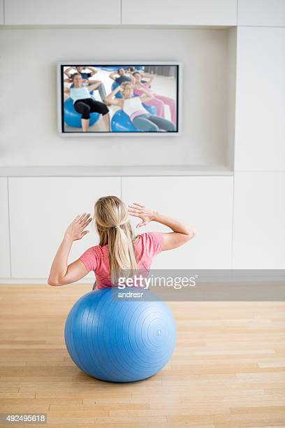 woman exercising at home - video still stock pictures, royalty-free photos & images
