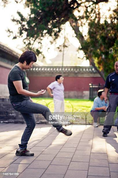 woman exercising at temple of heaven park. - merten snijders stock pictures, royalty-free photos & images
