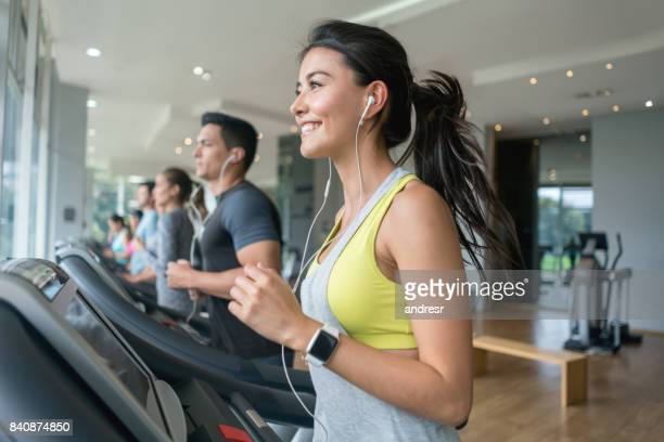 Woman exercising at the gym running on the treadmill