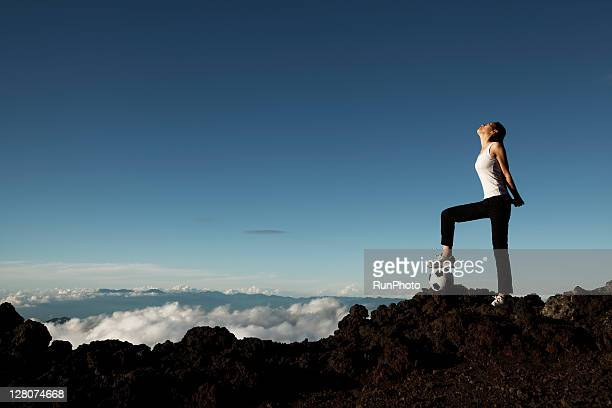 woman exercising at the mountain