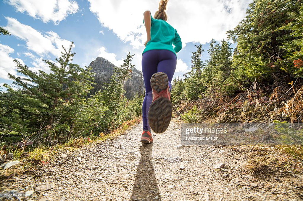 Woman exercising for cross-country running : Stock Photo