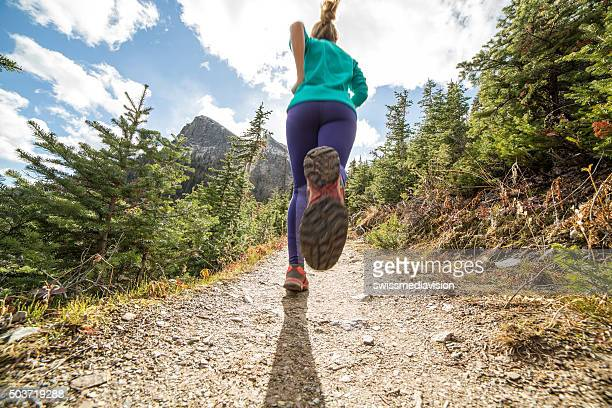 woman exercising for cross-country running - female feet soles stock photos and pictures