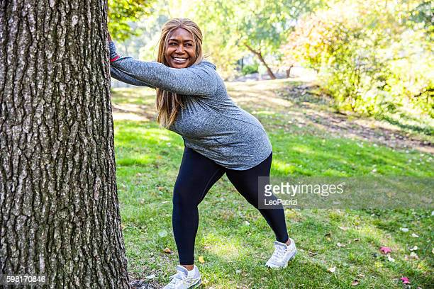 woman exercising in central park new york - images of fat black women stock photos and pictures