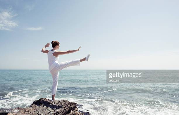 Woman exercising in front of the sea