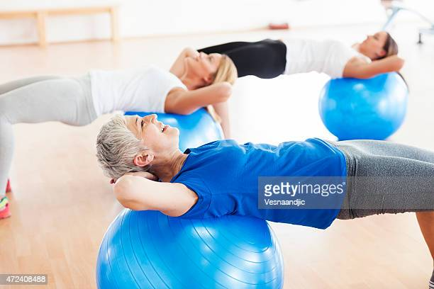 woman exercising in gym - fitness ball stock pictures, royalty-free photos & images
