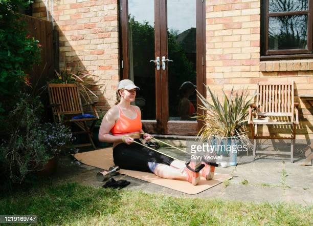 woman exercising in her garden - relaxation exercise stock pictures, royalty-free photos & images