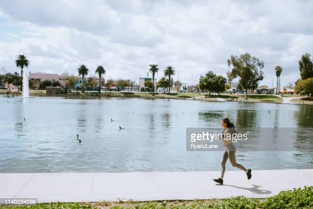 woman exercising in los angeles city park - puerto rican ethnicity stock pictures, royalty-free photos & images