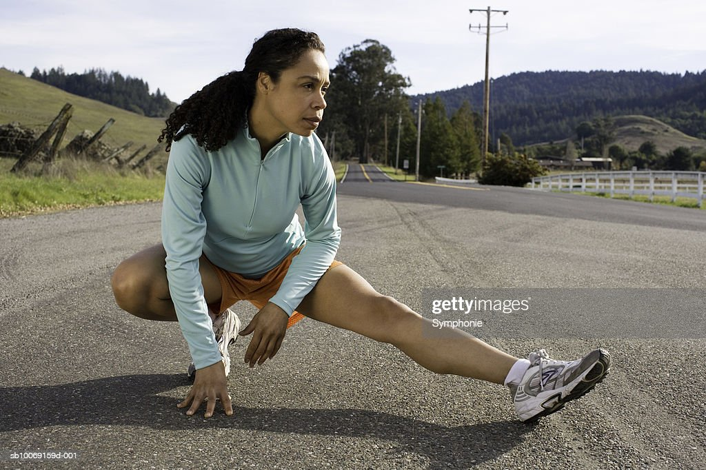 Woman exercising In street : Stockfoto