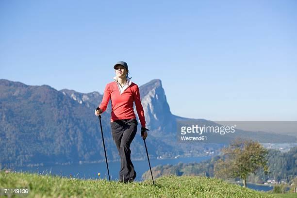 Woman exercising Nordic Walking, Austria, alps