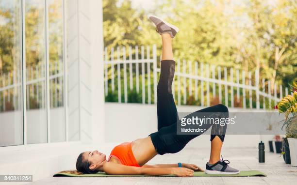 woman exercising on a porch - bare bum stock pictures, royalty-free photos & images