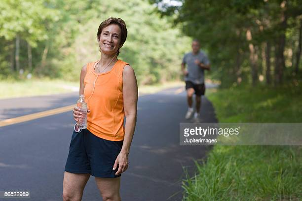 Woman exercising on road