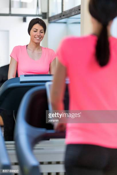 Woman exercising on spin machine