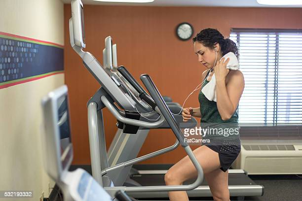 woman exercising on stairmaster in motel fitness room - fatcamera stock pictures, royalty-free photos & images