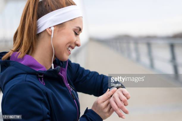 woman exercising on the bridge - headband stock pictures, royalty-free photos & images