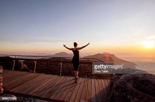 Woman exercising on top of Table Mountain