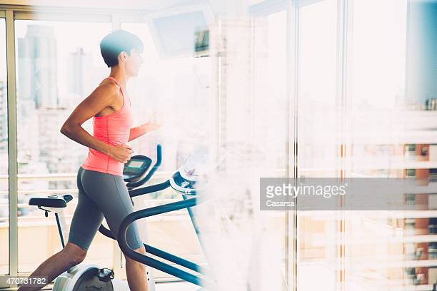 Woman exercising on treadmill