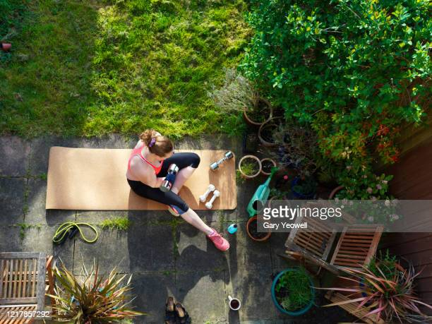 woman exercising outdoors - practising stock pictures, royalty-free photos & images