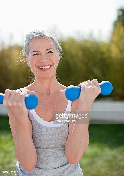 woman exercising outdoors - dumbbell stock pictures, royalty-free photos & images