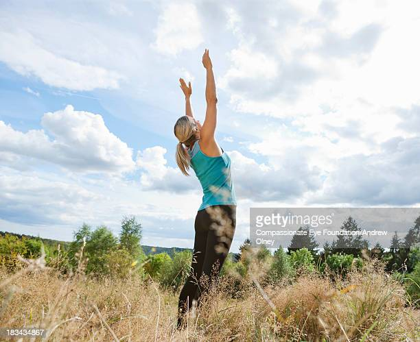 woman exercising outdoors - aylesbury stock photos and pictures