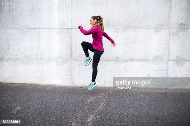 woman exercising outdoors - women's field event stock pictures, royalty-free photos & images